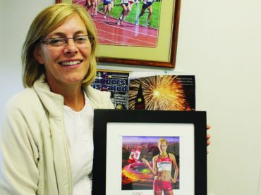 Mother of Olympian cheers from the sidelines