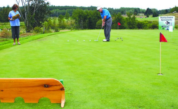 SFMH Golf Tourney Putting.preview.jpg