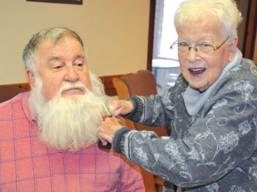 White beard gets sheared for charity