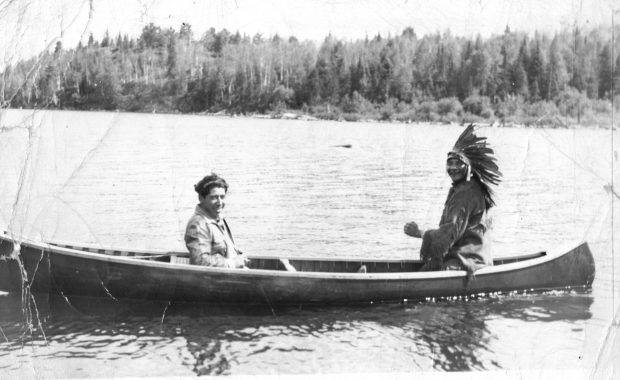 James Jocko being paddled on Canoe Lake in Algonquin Park.