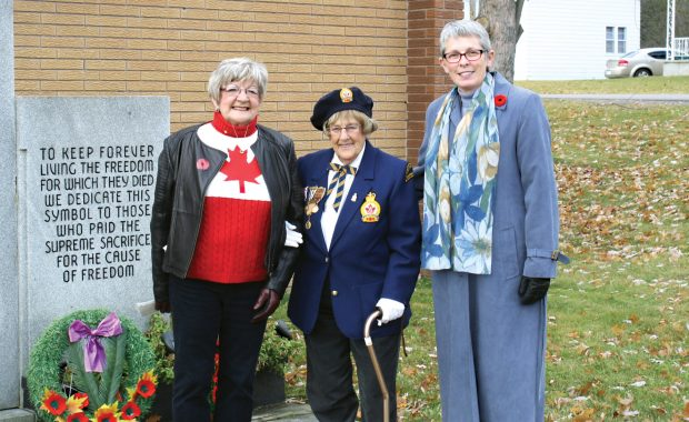 MVHS President Sharon Mahussier, War Bride Constance Chippure and Mayor Kim Love pose by the newly planted Remembrance Garden in front of the Royal Canadian Legion Branch 406.