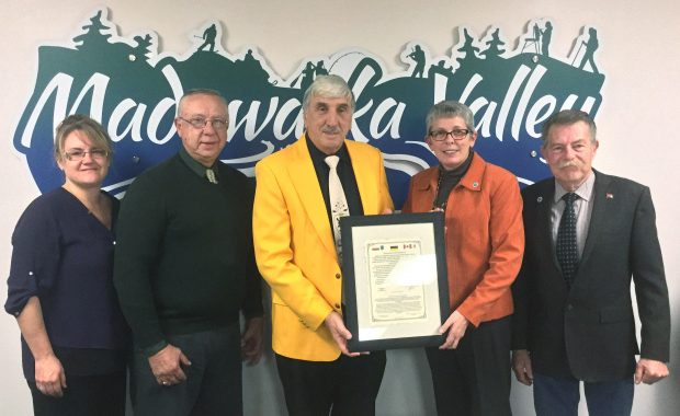Councillor Shelley Maika, Councillor Ernie Peplinski, David Shulist, Mayor Kim Love and Councillor Carl Bromwich holding the Declaration of Cooperation from Lipusz, Kashubia, Europe.