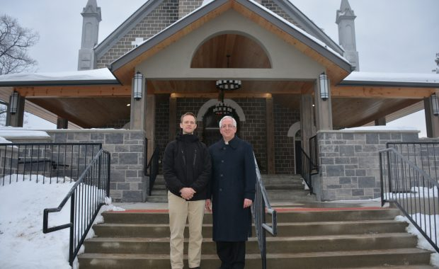 Project Manager Matthew Baklinski, left, and Father Chris Shalla stand at the new entrance in front of St. Hedwig's Church in Barry's Bay.