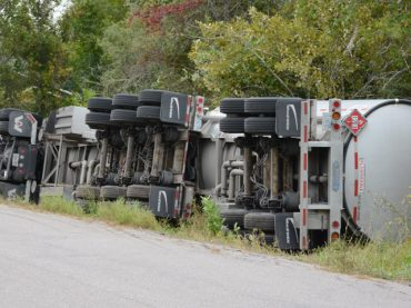 Truck rollover forces evacuation on Elm Street