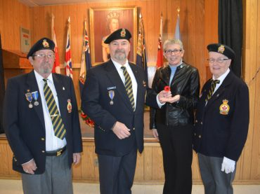 First poppy presented to Mayor Kim Love