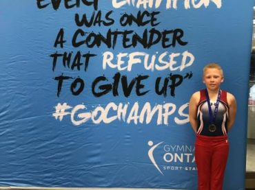Local gymnast finishes first in age group