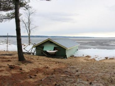 Wind driven ice damage to cottage on Round Lake
