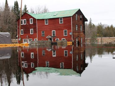 While Brennan's Creek brims its banks, the Old Killaloe Mill is sandbagged