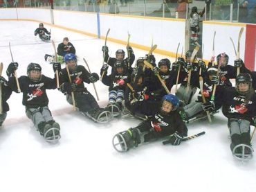 Local sledge hockey team scores funding