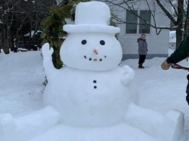 Snowman brings cheer in the making and the showing