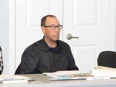 Council examines bids for library extension