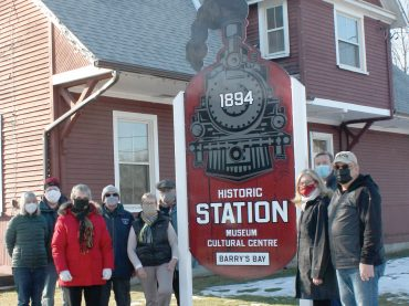 Stationkeepers raise new sign & find two classic Christmas stories